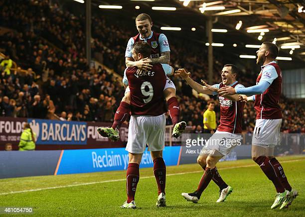 Sam Vokes of Burnley celebrates scoring the equalising goal with Kieran Trippier during the FA Cup Third Round match between Burnley and Tottenham...
