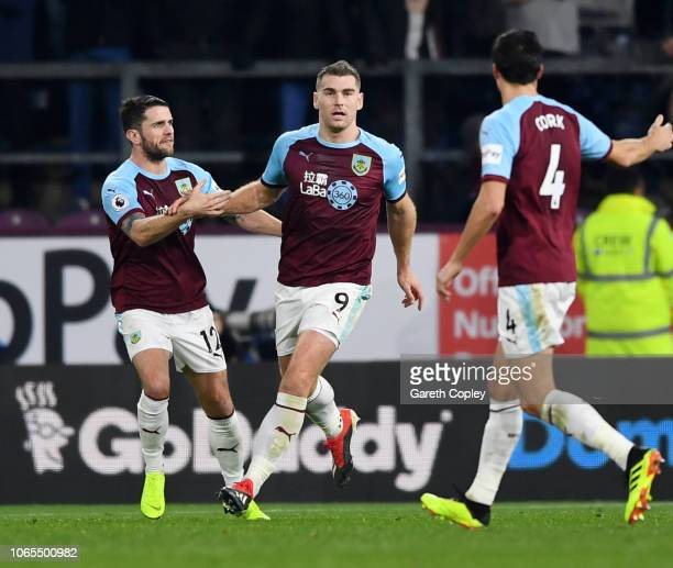 Sam Vokes of Burnley celebrates with his team mates Robbie Brady and Jack Cork after scoring their team's first goal during the Premier League match...
