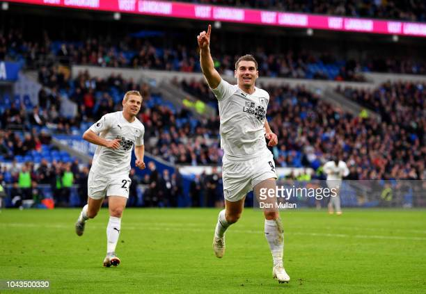 Sam Vokes of Burnley celebrates with team mate Matej Vydra after scoring his team's second goal during the Premier League match between Cardiff City...