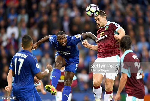 Sam Vokes of Burnley heads the ball while under pressure from Wes Morgan of Leicester City during the Premier League match between Leicester City and...