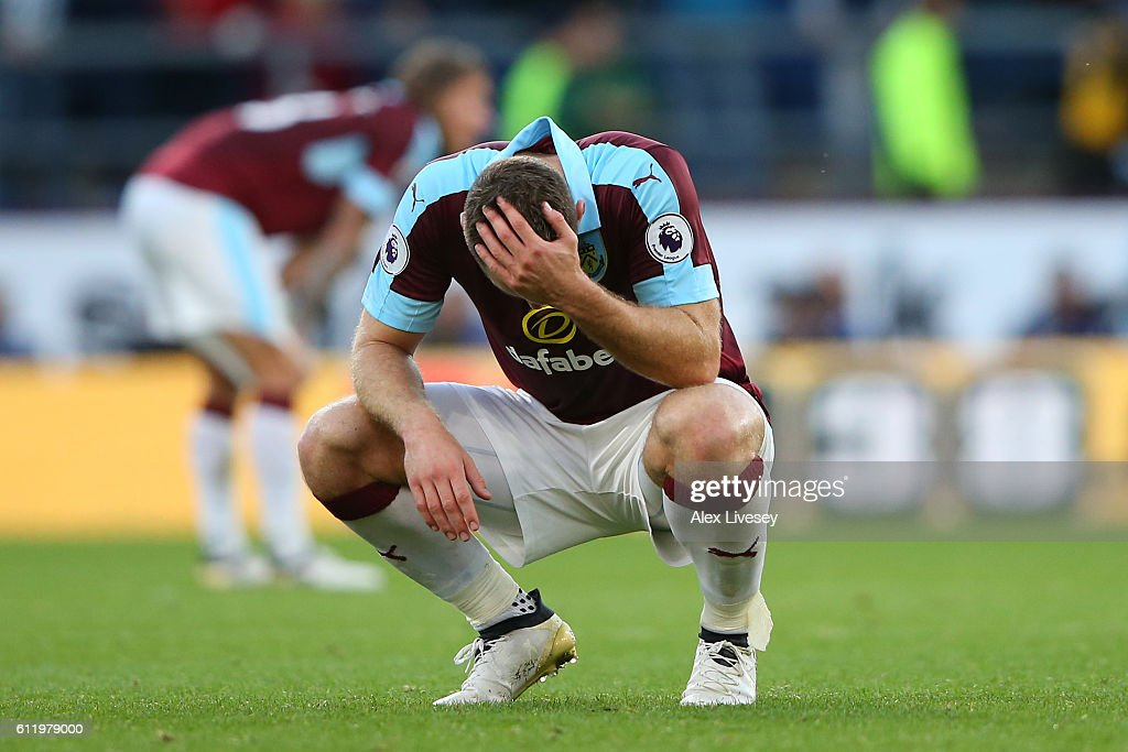 Sam Vokes of Burnley holds his head in his hands after the final whistle during the Premier League match between Burnley and Arsenal at Turf Moor on October 2, 2016 in Burnley, England.