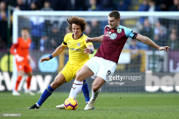 Sam Vokes of Burnley holds off David Luiz of Chelsea during the Premier League match between Burnley FC and Chelsea FC at Turf Moor on October 28...