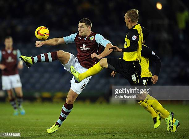 Sam Vokes of Burnley in action with Joel Ekstrand of Watford during the Sky Bet Championship match between Burnley and Watford at Turf Moor on...