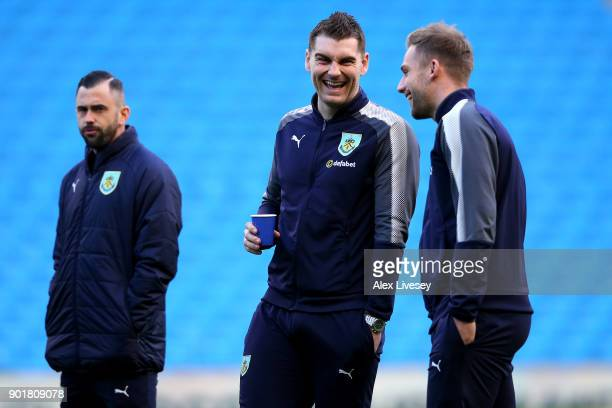 Sam Vokes of Burnley laughs with team mates prior to The Emirates FA Cup Third Round match between Manchester City and Burnley at Etihad Stadium on...