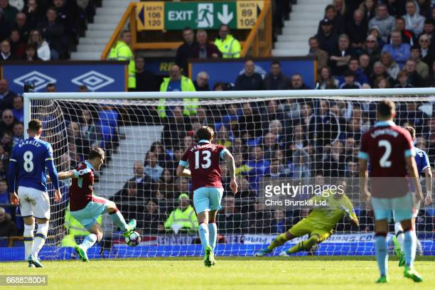 Sam Vokes of Burnley scores a penalty to make the score 11 during the Premier League match between Everton and Burnley at Goodison Park on April 15...