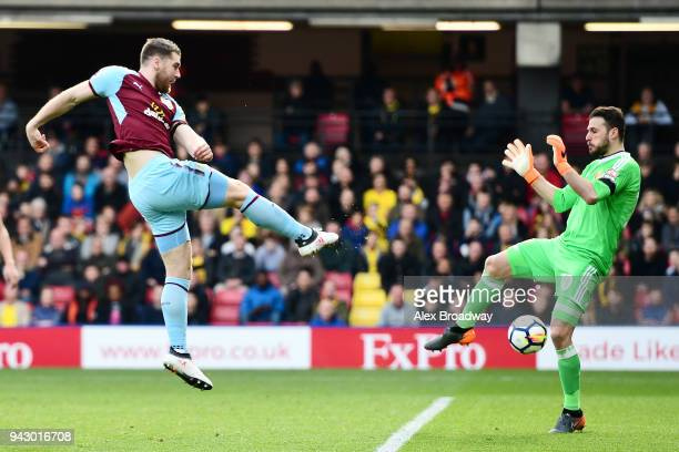 Sam Vokes of Burnley scores his sides first goal during the Premier League match between Watford and Burnley at Vicarage Road on April 7 2018 in...