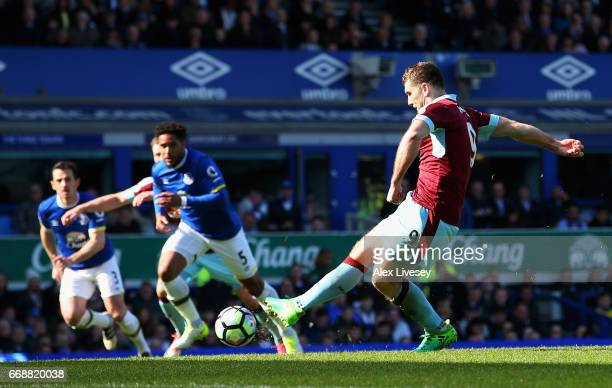 Sam Vokes of Burnley scores his sides first goal from the penalty spot during the Premier League match between Everton and Burnley at Goodison Park...