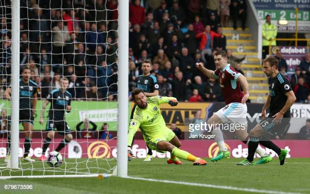 Sam Vokes of Burnley scores his sides first goal passt Ben Foster of West Bromwich Albion during the Premier League match between Burnley and West...