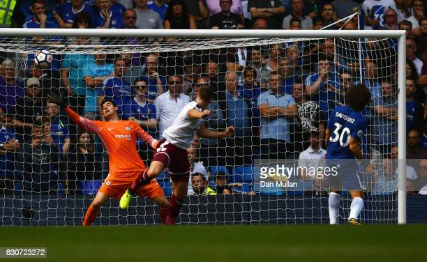 Sam Vokes of Burnley scores his sides third goal during the Premier League match between Chelsea and Burnley at Stamford Bridge on August 12 2017 in...
