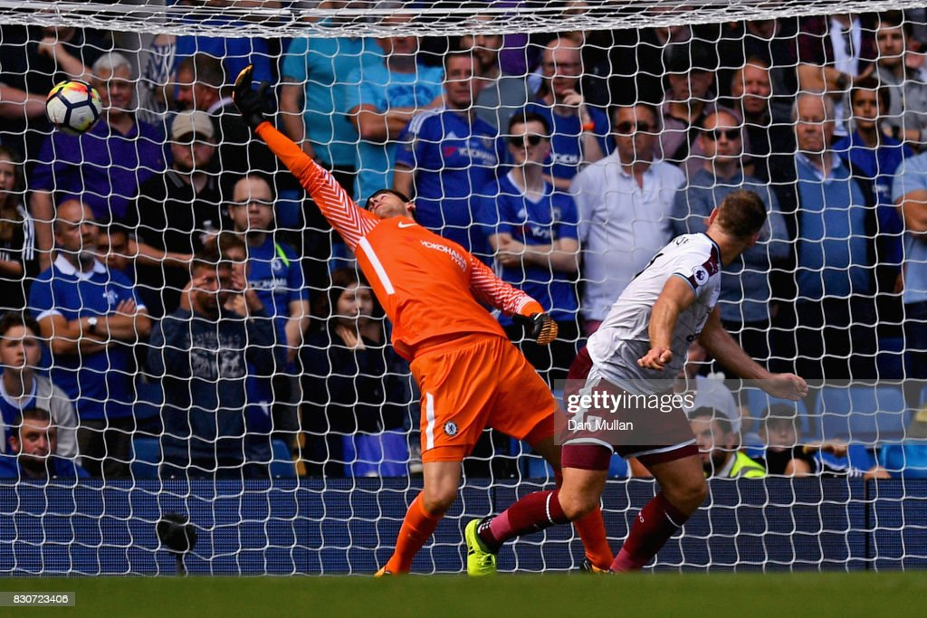 Sam Vokes of Burnley scores his sides third goal past Thibaut Courtois of Chelsea during the Premier League match between Chelsea and Burnley at Stamford Bridge on August 12, 2017 in London, England.