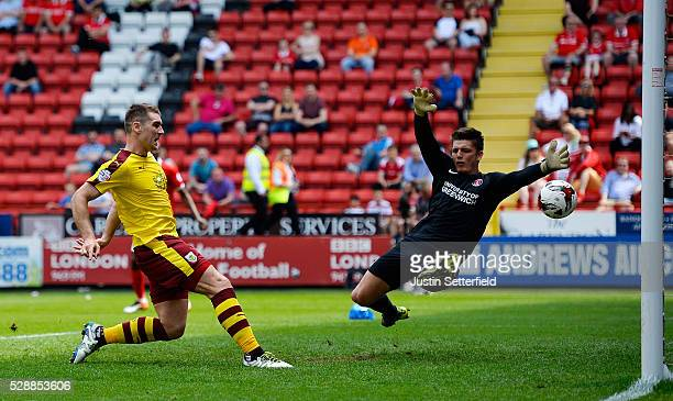 Sam Vokes of Burnley scores his team's first goal past Nick Pope of Charlton Athletic during the Sky Bet Championship match between Charlton Athletic...