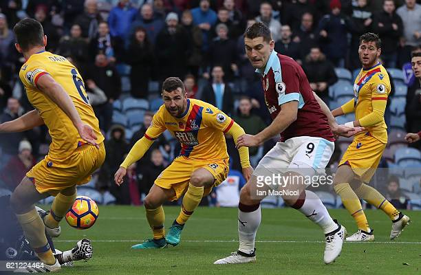 Sam Vokes of Burnley scores the opening goal during the Premier League match between Burnley and Crystal Palace at Turf Moor on November 5 2016 in...