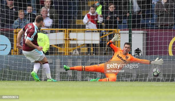 Sam Vokes of Burnley scores the opening goal during the Premier League match between Burnley and West Ham United at Turf Moor on May 21 2017 in...