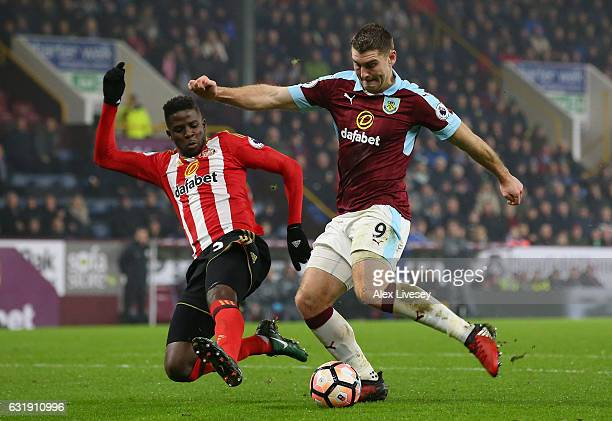 Sam Vokes of Burnley shoots while Papy Djilobodji of Sunderland attempts to block during the Emirates FA Cup third round replay between Burnley and...