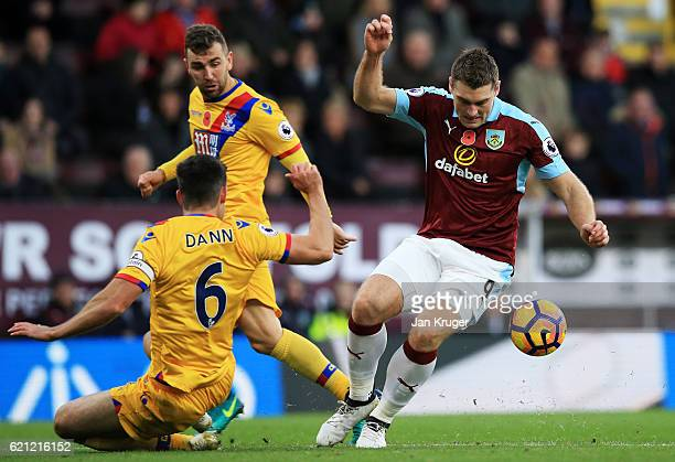 Sam Vokes of Burnley takes the ball past Scott Dann of Crystal Palace during the Premier League match between Burnley and Crystal Palace at Turf Moor...