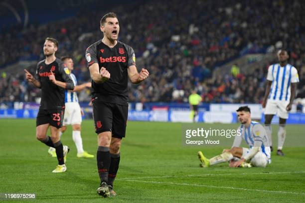 Sam Vokes of Stoke City celebrates after his sides second goal during the Sky Bet Championship match between Huddersfield Town and Stoke City at John...