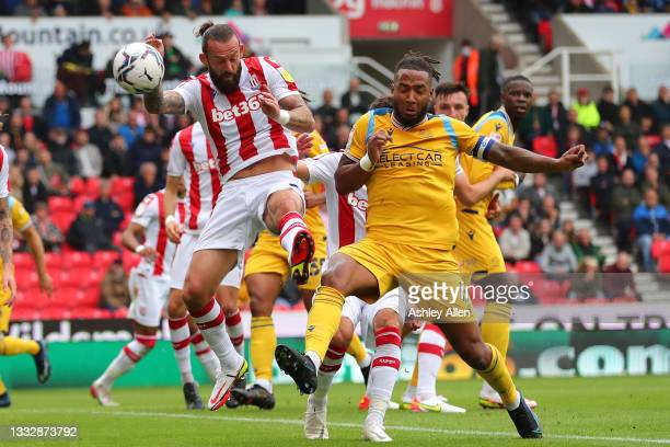 Sam Vokes of Stoke City is tackled by Liam Moore of Reading FC during the Sky Bet Championship match between Stoke City and Reading at Bet365 Stadium...