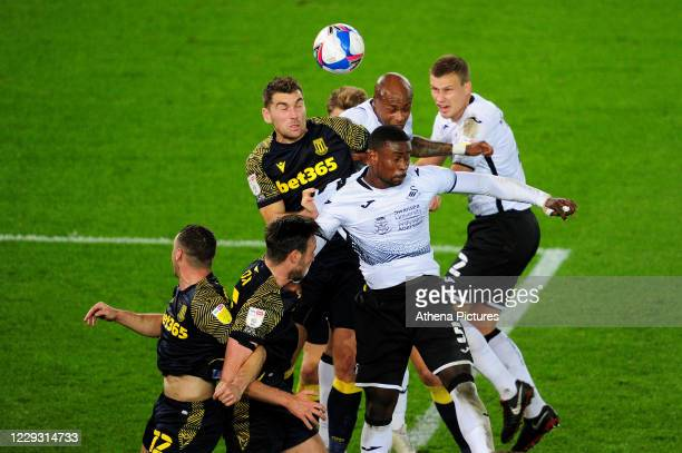 Sam Vokes of Stoke City vies for possession with André Ayew of Swansea City during the Sky Bet Championship match between Swansea City and Stoke City...