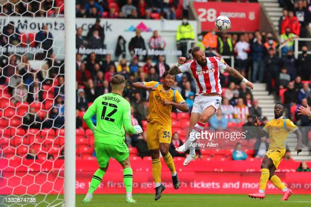 Sam Vokes of Stoke City wins the ball from Femi Azeez of Reading FC during the Sky Bet Championship match between Stoke City and Reading at Bet365...