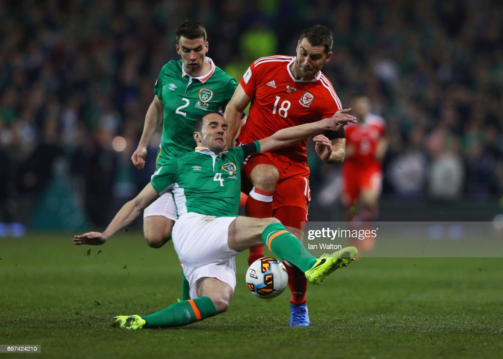 Sam Vokes of Wales battles with John O'Shea (4) and Seamus Coleman of the Republic of Ireland (2) during the FIFA 2018 World Cup Qualifier between Republic of Ireland and Wales at Aviva Stadium on March 24, 2017 in Dublin, Ireland.