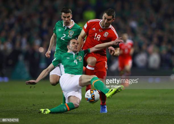 Sam Vokes of Wales battles with John O'Shea and Seamus Coleman of the Republic of Ireland during the FIFA 2018 World Cup Qualifier between Republic...