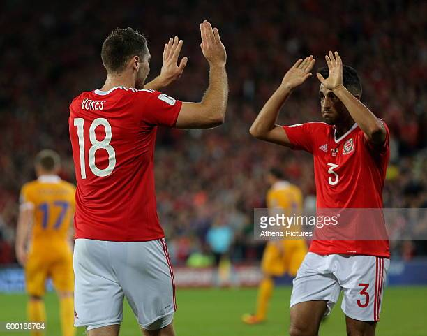 Sam Vokes of Wales celebrates his opening goal with team mate Neil Taylor during the 2018 FIFA World Cup Qualifier between Wales and Moldova at the...