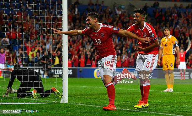 Sam Vokes of Wales celebrates scoring his sides first goal with team mate Neil Taylor during the 2018 FIFA World Cup Qualifier Group D match between...