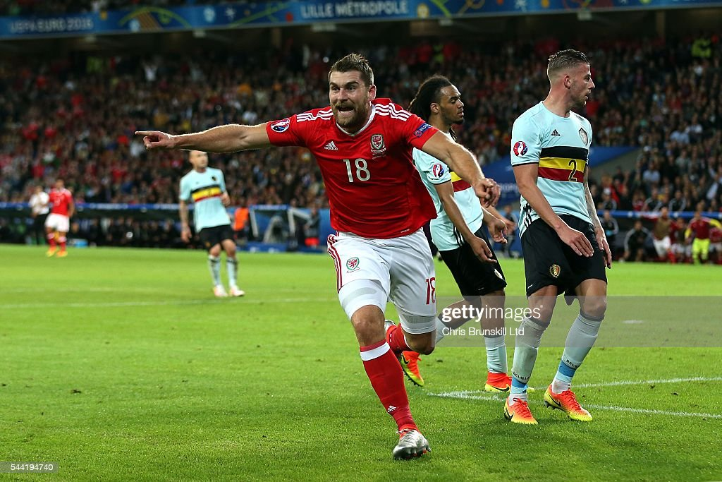 Sam Vokes of Wales celebrates scoring his side's third goal during the UEFA Euro 2016 Quarter Final match between Wales and Belgium at Stade Pierre-Mauroy on July 1, 2016 in Lille, France.