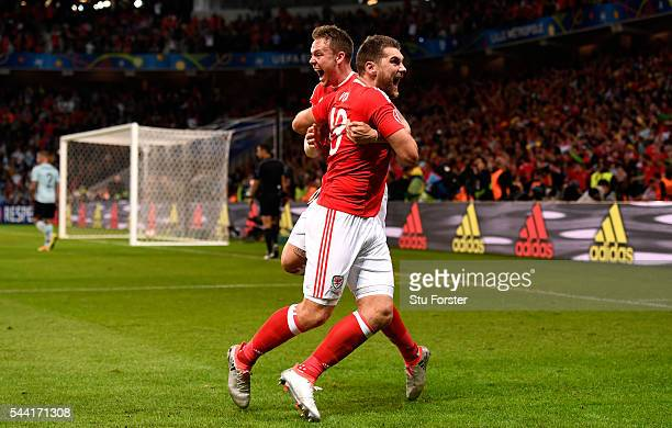 Sam Vokes of Wales celebrates scoring his team's third goal with his team mates Chris Gunter during the UEFA EURO 2016 quarter final match between...