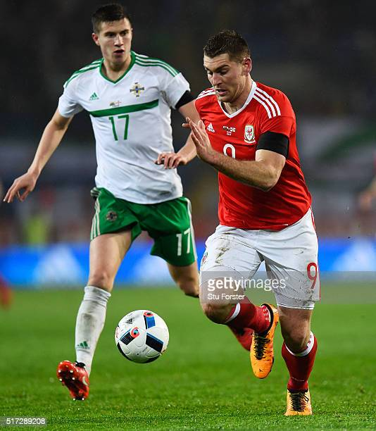 Sam Vokes of Wales controls the ball as Paddy McNair of Northern Ireland closes in during the international friendly match between Wales and Northern...