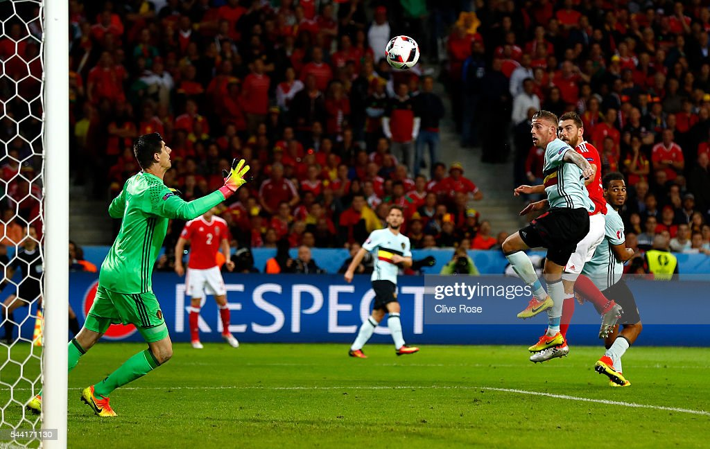 Sam Vokes (2nd R) of Wales heads the ball to score his team's third goal past Thibaut Courtois (1st L) of Belgium during the UEFA EURO 2016 quarter final match between Wales and Belgium at Stade Pierre-Mauroy on July 1, 2016 in Lille, France.