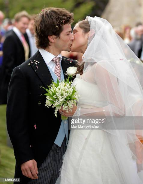 Sam Waley-Cohen and Annabel Ballin kiss after their wedding at St. Michael and All Angels church on June 11, 2011 in Lambourn, England.