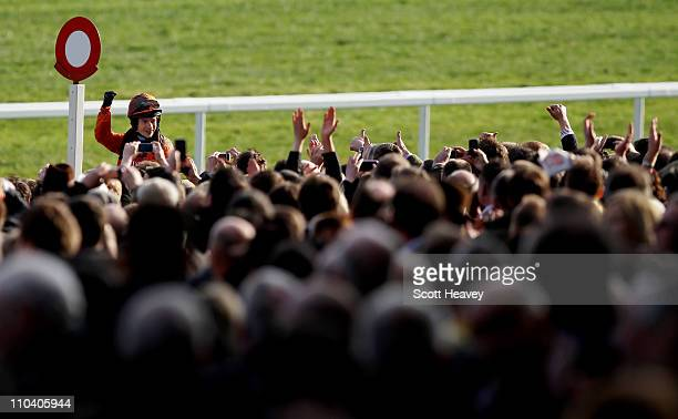 Sam WaleyCohen celebrates in front of racegoers after winning the Gold Cup on Long Run at Cheltenham Racecourse on March 18 2011 in Cheltenham England
