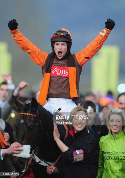 Sam WaleyCohen celebrates on Long Run as they are led in after winning the totesport Cheltenham Gold Cup Chase at Cheltenham Racecourse on March 18...