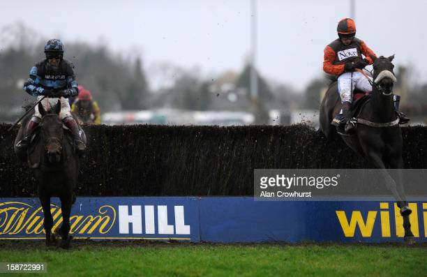 Sam Waley-Cohen riding Long Run clear the last to win The William Hill King George VI Steeple Chase from Captain Chris at Kempton racecourse on...