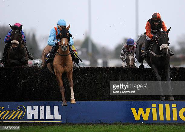 Sam Waley-Cohen riding Long Run on their way to winning The William Hill King George VI Steeple Chase at Kempton racecourse on December 26, 2012 in...