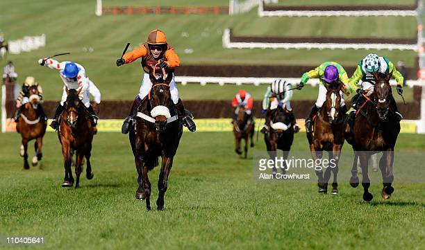 Sam Waley-Cohen riding Long Run win the totesport Cheltenham Gold Cup Chase from Denman and Kauto Star at Cheltenham racecourse on March 18, 2011 in...