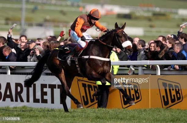 Sam WaleyCohen wins the Gold Cup on Long Run at Cheltenham Racecourse on March 18 2011 in Cheltenham England