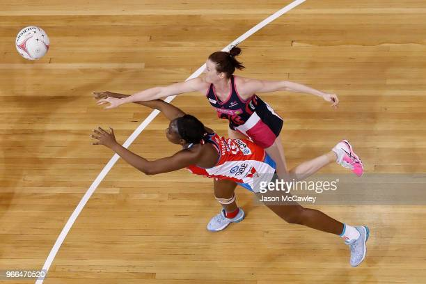 Sam Wallace of the Swifts and Kate Shimmin of the Thunderbirds compete for the ball during the round six Super Netball match between the Swifts and...