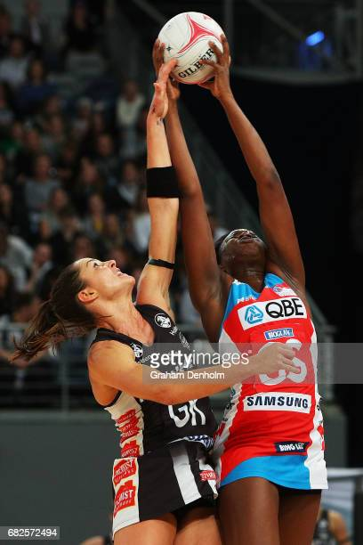 Sam Wallace of the Swifts and Sharni Layton of the Magpies compete in the air during the round 12 Super Netball match between the Magpies and the...