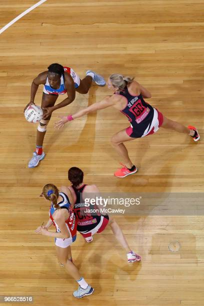 Sam Wallace of the Swifts is challenged by Leana De Bruin of the Thunderbirds during the round six Super Netball match between the Swifts and the...