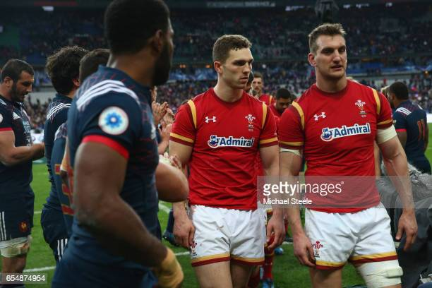 Sam Warburton and George North walk past Noa Nakaitaci of France after their sides 1820 defeat during the RBS Six Nations match between France and...