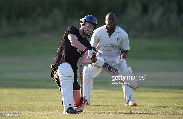 Sam Warburton of Northampton Town looks to hit out during a 20/20 Cricket Match between Bold Dragoon CC and Northampton Town FC in aid of the Leon...