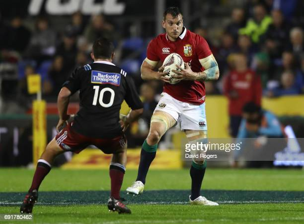 Sam Warburton of the British Irish Lions is challenged by Bryn Gatland of NZ Provincial Barbarians during the 2017 British Irish Lions tour match...