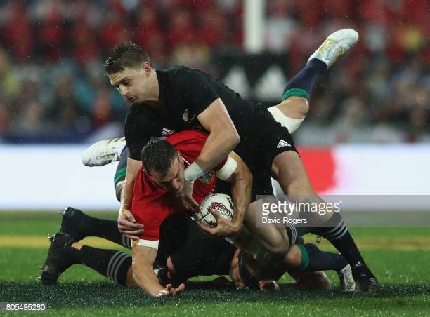 Sam Warburton of the Lions is tackled by Beauden Barrett during the match between the New Zealand All Blacks and the British Irish Lions at Westpac...