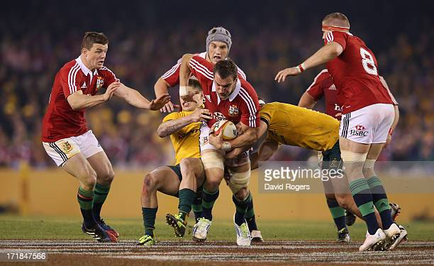 Sam Warburton of the Lions is tackled by James O'Connor and Michael Hooper during game two of the International Test Series between the Australian...