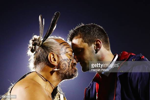 Sam Warburton of the Lions receives a hongi from a Maori Chief after winning the match between the New Zealand Provincial Barbarians and British &...