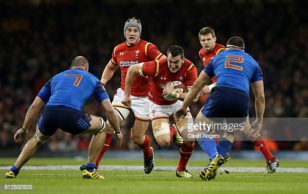 Sam Warburton of Wales charges towards Antoine Burban and Guilhem Guirado of France during the RBS Six Nations match between Wales and France at the...
