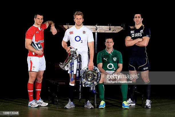 Sam Warburton of Wales Chris Robshaw of England Jamie Heaslip of Ireland and Kelly Brown of Scotland pose with the Six Nations trophy and the Triple...