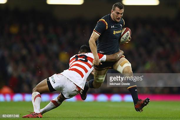 Sam Warburton of Wales is held up by Timothy Lafaele of Japan during the International match between Wales and Japan at the Principality Stadium on...
